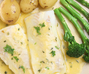 Halibut with Butter and Herb Sauce served with Broccoli and Potatoes