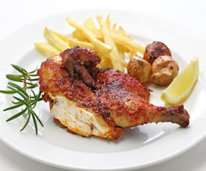 Piri Piri Chicken leg with potatoes and lemon